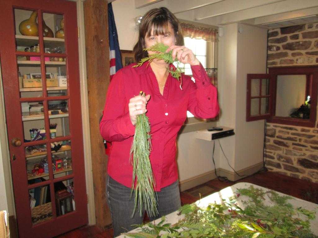 Debbie using greens to decorate The Moland House