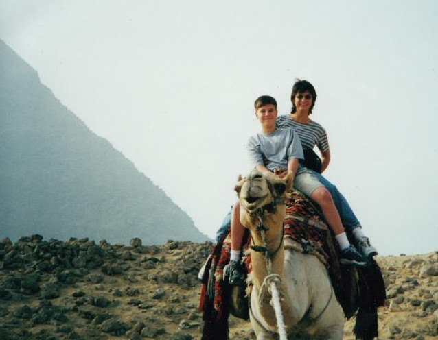 Debbie and son Nathan on a camel in Egypt